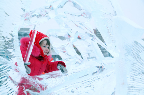 Girl-Bundled-Up-with-Ice-Sculpture