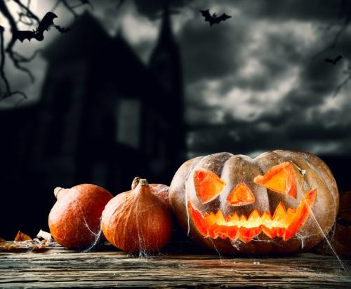Carved-pumpkins-with-cobwebs-on-wood
